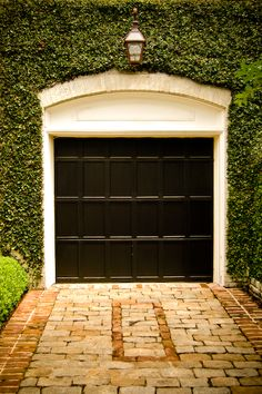 Pink house with white trim, black metal roof and black doors. Love this garage door and the ivy but Jason requests no ivy at the new house on account of my ivy addiction. Black Garage Doors, Black Doors, Garage Entry, Barn Garage, Dream Garage, Houses Architecture, Architecture Details, Exterior Design, Interior And Exterior