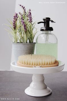 Bell Glass Soap Dispenser with Antique Bronze Metal Pump. www.rail19.com Soap Dispenser Display Ideas.   RAIL19 offers a large selection of glass soap dispensers and glass spray bottles for every kitchen, bath, laundry and vanity. Update your kitchen and bath in style!