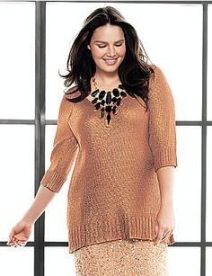 this shirt is a must have for the office holiday party . Warm for the season with a sophisticated gleam that goes anywhere, this luxe design features a deep V-neckline and ribbed trim on 3/4 sleeves and hem. Trendy longer length is lovely dressed up or down. lanebryant.com #plussize