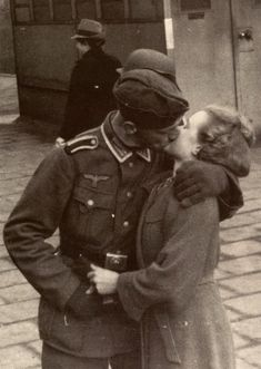 a German soldier  kisses his loved one