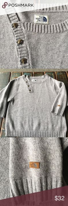 """North Face Gorgeous Gray Wool Sweater 💕 This sweater is BEAUTIFUL! I love this sweater but it just isn't the right size anymore. Pretty medium gray color with brown button accents. Extra button sewn underneath. 55% wool, 30% nylon, 15% viscose. 3/4 sleeves. 22.5"""" across front of sweater. 26"""" long. Very light pilling under arms and where arms hit side of sweater. Not very noticeable but want to disclose all. Super condition! The North Face Sweaters Crew & Scoop Necks"""