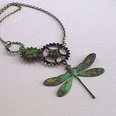 There is something magical about dragonflies. I have a lily pond and love to watch them skim the water. This Decorative Verdigris Brass Dragonfly is accented with 3 Verdigris Brass Gears on the Antiqued Brass Chain, giving it a steampunk vibe.