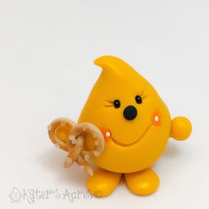 Parker with Salted Pretzel - Polymer Clay Character Figurine by KatersAcres on…