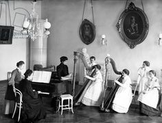 A harp lesson at the Smolny Institute (b/w photo)