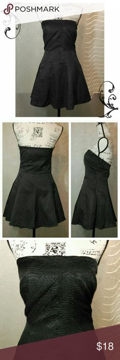 """Strapless Black Dress Excellent Condition!  Great quality fabric with a unique diagonal pattern style. Bottom flares with tulle underneath (last picture). Fits me great at 36C, 28""""waist, just a tad too short for me. Great for Parties or just going out! Zipper closure on the side. Dresses Strapless"""