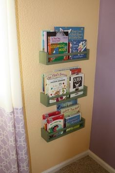 Ikea $2.99 spice racks, spray painted and mounted on a bedroom wall to hold books.