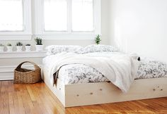 DIY Simple Bedframe @themerrythought with a dark stain