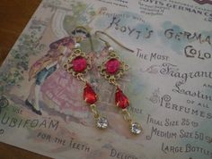 Vintage sparklers - featuring vintage Swarovski rhinestone jewel charms and Florentine ruby red charm
