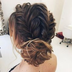 Fishtail braids into chignon wedding hairstyle