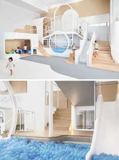 A simple color palette of wood, white, and blue (and a touch of grey) make up this fun space that includes a slide that ends in a ball pit, as well as stairs and small nooks, perfect for kids to play in.