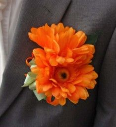 Grooms Double Orange Silk Gerbera Wedding Day Buttonhole with Mnt Green Ribbon Bow.