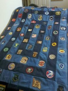 Quilt made from denim jeans and military patches. A great way to display and recycle. It would work for girl and boy scout patches too!