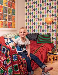 Nice colourfull. I also like that it could be a girls room too (I am tired of all those stereotype boys and girls room cliches)