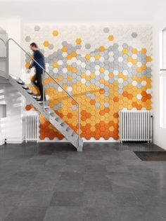 Hexagonal wool & wood sound absorbing tiles. By: Form Us With Love from Sweden.