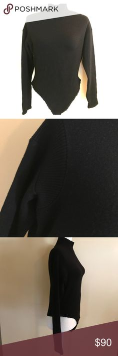 DKNY Black bodysuit Wool blend black DKNY bodysuit. Attention to detail throughout; ribbing on the shoulder and neck with a lace trimmed bottom. Worn only one time. Dkny Tops
