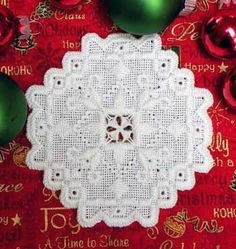 """NEWEST!    Start a tradition this Christmas with Rozs new Keepsake Ornament Design!  Everything you need to create this beautiful Hardanger design is included in the kit - even the clear plastic hinged case for safe storage of your ornament!  Finished design is 3.75"""" x 3.75"""".  Kit includes the case, 22 count white Hardanger fabric, DMC pearl cotton in sizes"""