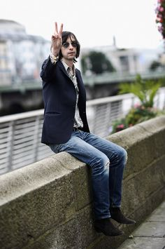Primal Scream's Bobby Gillespie was rushed to hospital on Thursday night after falling off the stage during an energetic performance at Swiss festival, Caribana.