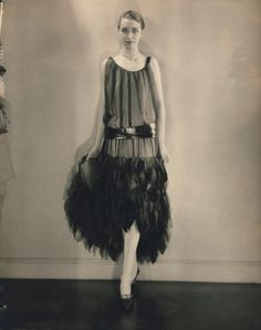 Edward Steichen, Marion Morehouse (aka Mrs. e. e. Cummings), Louiseboulanger dress, 1926 ca. 1926 --- Marion Morehouse (aka Mrs. e. e. Cummings) wearing a sleeveless black chiffon dress with an unevenly hemmed skirt of velvet and chiffon petals, and a cire satin girdle; designed by Louiseboulanger --- Image by © Condé Nast Archive/CORBIS