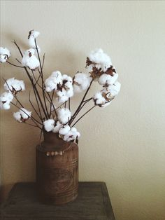 Rustic old water can with cotton stems; rustic home decor; boho; bohemian home decor; farmhouse