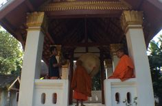 The city of Luang Prabang is well known for its many Buddhist temples and monasteries. The temple of Wat Wisunalat represents the earliest form of Lao temple architecture. During the early morning and late afternoon, drums can be heard around the city calling monks for prayers and to mark other special occasions. Click photo to play sound.