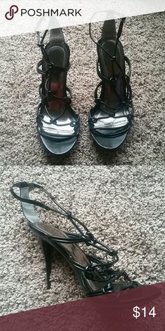 Black Strappy Heels Sexy black strappy heels. In great condition! No rips, tears, stains etc.  Only used once :)  For some reason, they don't say what size they are but I am a 8.5 - 9 Shoes Heels