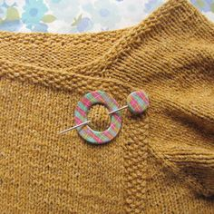 Plaid polymer shawl pin on handknit sweater by lisaclarke, via Flickr
