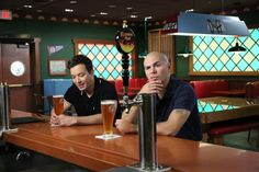 What's a few beers between friends? Jimmy Fallon and Pitbull grab a drink at Moe's Tavern at Universal Studios Florida on June 19 in Orlando, Fla.