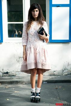 #Flatform sandals worn with socks offer a fun take on fall footwear, but Valentina's loose drop-waist dress from #Blumarine (in the perfect shade of petal pink) is the real show-stealer.