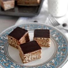 One of the most popular Croatian cakes, Madjarica. Beautiful layers of chocolate filling and pastry make a perfect moist cake.