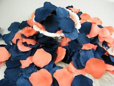 This listing is for 500 artificial rose petals in the combination color pack of Coral and Blueberry Blue petals.   The Blueberry Blue is a dusty light navy color. If you wish to have a darker navy, I do have a deep navy blue as well. See shop section Rose Petals / Wedding for all the colors or Contact me through Etsy Conversations and I am happy to help find the color you are searching for. Need a sample first ?...check sample listing below...  They are packaged in one polybag. They range in…