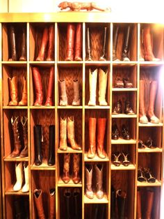 cowboy boots. I wish I owned that many boots at one time to put them all in a stand :( but I'm sure my mom owns enough boots to fill it from her barrel racing days ;D
