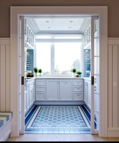 The kitchen is worth its own mention here. It's sparkling white cabinets and sea blue backsplash is a gorgeous blend of the Provence style and something you might find on Nantucket. The French doors are another nice feature, making it all the easier to shut away the dinner party mess and saving it for morning.
