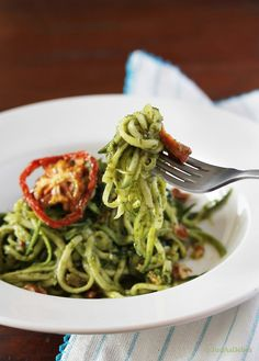 Zucchini Noodles (Zoodles!) with Sundried Tomato Pesto by Just As Delish. Raw zucchini noodles with sundried tomato pesto. Sundried tomatoes add a sweet flavour to the plain pesto. No cooking, just peeling and blending for this recipe