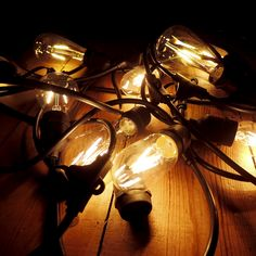 Vintage LED filament festoon lighting with a variety of ultra warm Edison-style bulbs - created at home & now available commercially.