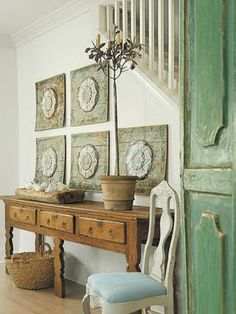 from the green shutters to the pine console and basket on the floor i am smitten with this