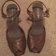Madden Girl brown heels.  Size 7.5 Madden girl!  Worn but with a lot of life left.  Normal wear from wearing!  7.5.  Has a platform and a unique peep toe! Madden Girl Shoes Heels
