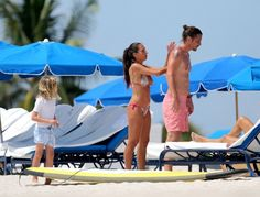 Vicky Karayiannis Photos Photos - Soundgarden frontman, Chris Cornell, his wife Vicky Karayiannis and their children Toni and Christopher play on a paddle board while on a family vacation in Miami Beach. - Chris Cornell and Family Vacation in Miami