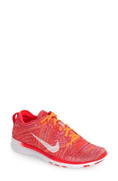 Crushing on these bold crimson and orange Nike training shoes.
