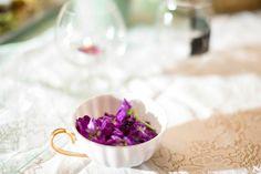 Teacup of purple stock flowers. Purple wedding details.
