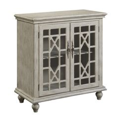Bring elegant style to your living room or entryway with this eye-catching cabinet, showcasing latticed glass doors and a weathered ivory finish.