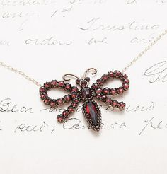 Victorian Garnet Butterfly and Bow Necklace, $600.00