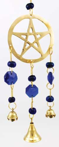 This brass pentagram wind chime boldly displays the sign of faith accompanied by three musical bells and translucent blue beads that catch the sun in a perfect complement to the brass.