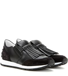 Tod's - Sportivo Frangia leather sneakers - Tod's shows their take on sneakers loaded with statement appeal. The sleek black pair feature tonal fringe to the front and studs at the heel for an urban finish. Try them with leather leggings for a truly contemporary look. seen @ www.mytheresa.com