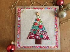 Christmas card, fabric applique card, hand embroidered , handmade greeting card, fabric card This greetings card is ideal for that special Christmas card. I have used liberty tana lawn fabric and machine appliqued a Christmas tree onto a vintage linen background, which is then
