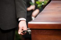 Coffin bearer carrying casket at funeral. Religion, death and dolor - coffin bea , Cremation Or Burial, Moral Responsibility, Funeral Costs, Religious Rituals, Funeral Planning, Pre Paid, Veterans Affairs, How Many People, Corona