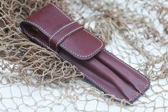 Double pen case made with a Wine Latigo 7oz. genuine cow hide leather. Fits pens up to 6 1/2long (15.5 cm) with a diameter of approx. 5/8. The case is finely finished with a wood rub on the edges. The stitches are doubled around the loop to reinforces the closure system. The case is