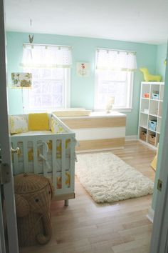 Cool Adorable and Cozy Baby Nursery Room Design Idea in a Turquoise Color. Love the daschund and the elephant clothes hamper.