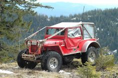 """Super Jeep is a combination of a 1942 chassis and body, fenders from a '42 that were modified into """"high fenders"""", a custom built hood, lengthened grille, modified windshield and lengthening. The frame is 15-inches longer and body is 25-inches longer. Fits 47's under the fenders. This beast is owned and fed by Carl Jantz."""