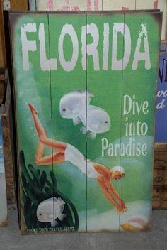 Dive into Paradise vintage sign