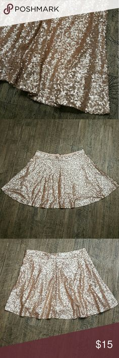 Bethany Mota Blush Champagne Sequin Skater Skirt L This adorable Bethany Mota (for Aeropostle) skater skirt has a lot of bling and sparkle! It features blush champagne sequins all over, and is fully lined on the inside. Size large.  It has a zipper on the back with a hook & eye closure.   Please note: there is a light stain on the inside of the lining, it can be seen close-up in the last photo. It does not effect the exterior at all, and is not visible once the skirt is on. Bethany Mota…